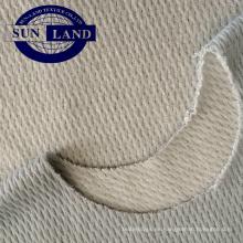Cálido tejido de algodón de fibra de poliéster en forma de panal de pájaro.