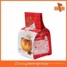 Guangzhou impressão e embalagem fabricante grossista laminado material personalizado gravura impresso gusset lateral saco de plástico