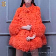 Las nuevas muchachas de la manera rebordean el abrigo de pieles del cordero El abrigo de las pieles del oveja de Tíbet corta el sobretodo