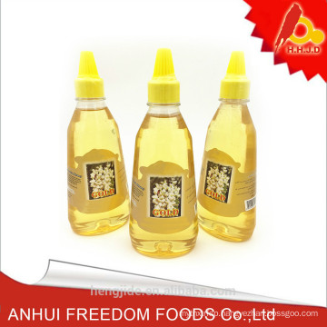 pure natural mature acacia honey packed in 500g plastic bottle
