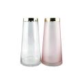 Прозрачная и розовая стеклянная ваза с золотой оправой