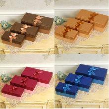 Cores diferentes caixas de presente de papel especial brilho com fita