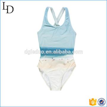 O swimwear de uma peça só personalizado das crianças do biquini imprimiu o desgaste bonito da praia