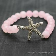 Pulsera de piedras preciosas del estiramiento de los granos redondos del cuarzo 8MM de Rose con la pieza de las estrellas de mar de la aleación de Diamante
