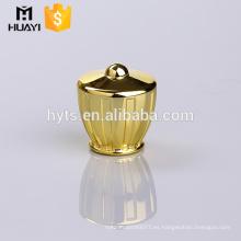 Tapa de botella de perfume de color dorado