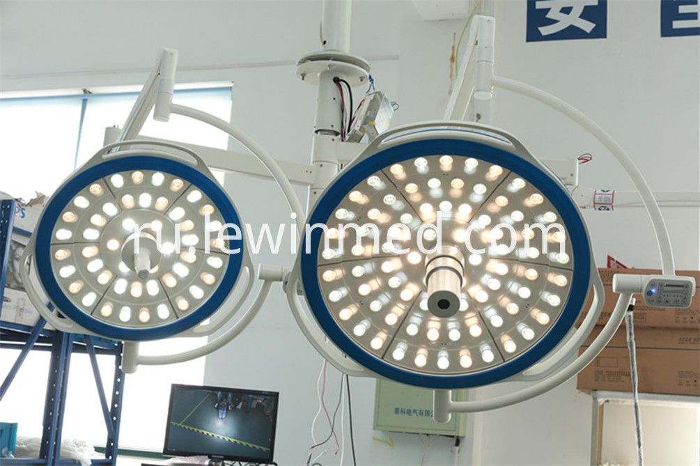 Double arm surgical light
