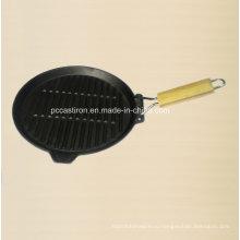 Круглый законченный маслом чугунная сковорода с деревянной ручкой