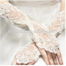 Kundenspezifischer Entwurf weg von den weißen Handgelenk-Längen-Handschuhen Fingerlose Spitze-Brauthandschuhe