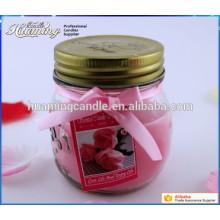 Стеклянная свеча с ароматическими ароматическими свечами в стеклянной банке