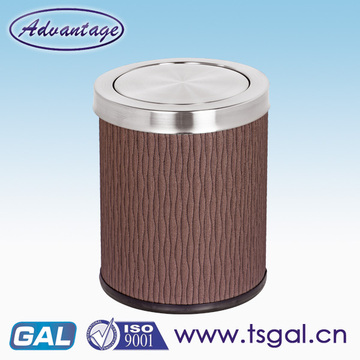 Metal trash can with swing lid