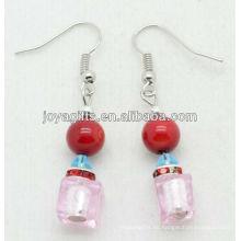 Cristal rosa con pendientes de cuentas de coral rojo natural