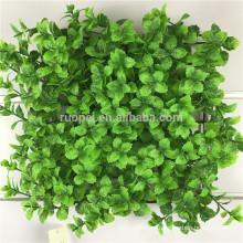 Follaje de privacidad de hojas verdes artificiales ornamentales para pared