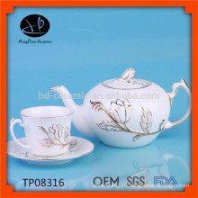 White ceramic pot with gold rim,innovative embossed tea pot with cup and saucer,ceramic kettle with flower design
