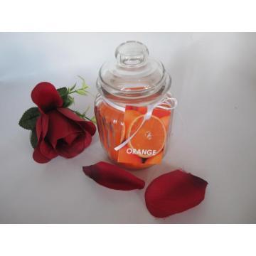 Bougie en verre de couleur orange parfumée