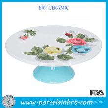 Las rosas elegantes redondean los soportes al por mayor de la torta de la cerámica