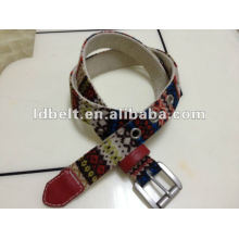 Knitted fabric with web belt