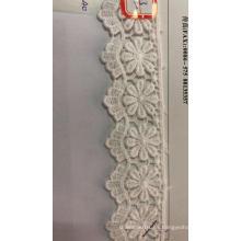 Tela bordada de algodón con adornos de flores onduladas de ocho pétalos