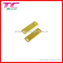 Plaque en métal brillant en or pour maillots de bain