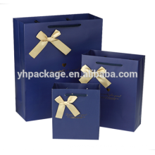 2018 Gold Logo Stempelband Bogen blau bedruckten Papier Verpackung Tasche