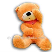 light brown stuffed doze bear scarf teddy bear