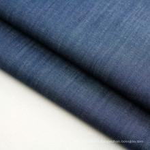 Tissu de denim d'indigo teint par fil de coton de stock pour la robe et la chemise