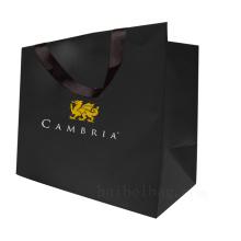 Sac à provisions cadeau en papier Kraft personnalisé pour l'emballage d'habillement