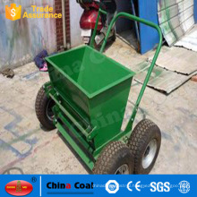 mini hand push type sand infill machine