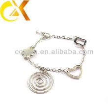 Pulsera de joyería de acero inoxidable con corazón y colgante de flores para niña encantadora