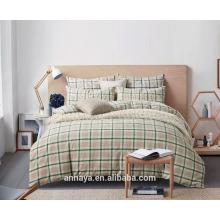 Los estilos de Muji lavaron ropa de cama de algodón con cuadros