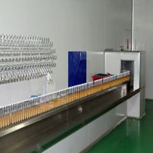 automated spray for pen machine
