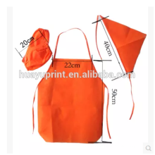 Le tablier de l'enfant fait, le tablier à manches non-tissé jetable à l'école maternelle, l'anti-huile imperméable à l'eau peut être imprimé LOGO