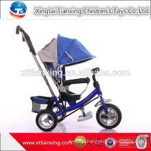 Игрушка оптом трехколесный велосипед с резиновым покрытием, трицикл для детей с нажимным баром и навесом