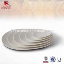 Assiette ovale en porcelaine blanche ovale en céramique 10 pouces de Haoxin