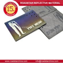 Mann-Jeans-reflektierende Leder-label