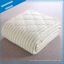 Manta individual de algodón con sábanas y edredones