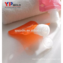 Cheap and fine plastic PE+PET cute pink square shape portable carry-on shampoo /cream bottle/bag injection mould
