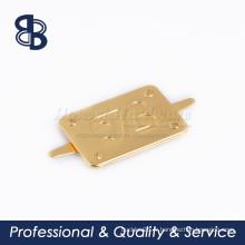 Étiquette de logo en métal à main