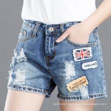 Pantalones cortos de jean cortos de mezclilla de las mujeres al por mayor de la fábrica