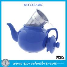 Tetera de cerámica azul redonda con colador de té inoxidable
