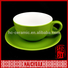 Ceramic bright colored tea cups and saucers