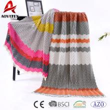 Couverture drapée multicolore 100% acrylique