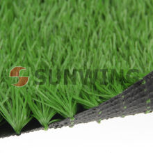 Outside children playing football fields artificial sward