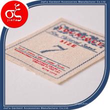 Étiquette / étiquette de tissu imprimée par logo de marque de toile personnalisée