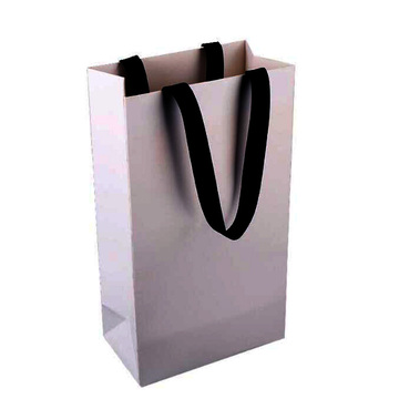 Shopping bag in carta bianca personalizzata con manico