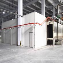 Système de revêtement en poudre avec cabine de pulvérisation et prétraitement de pulvérisation