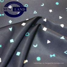 El papel del diseño del cartón del poliéster 100 imprimió la tela del dispositivo de seguridad de FDY para el paño del niño