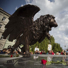 Large bronze winged metal lion sculpture