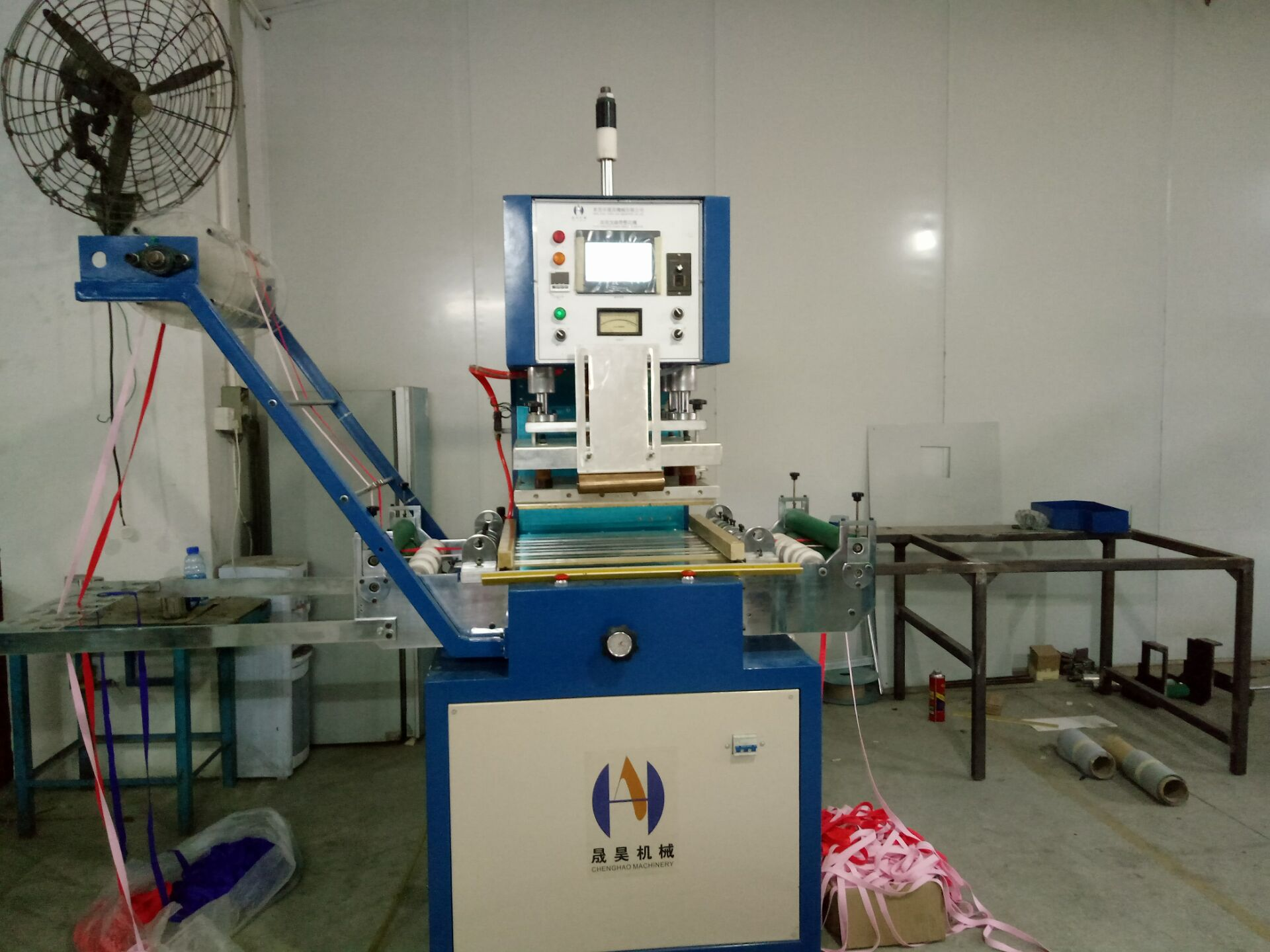 Ribbon logo embossing machine