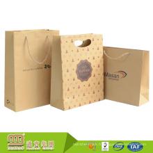 Personnalisé Logo Conception Brown Patch Trou Die Cut Poignée Biodégradable Papier Sac Kraft Avec Prix Concurrentiel