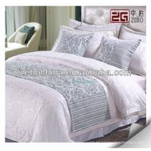 Suministro de camas y cojines decorativos para cama de hotel
